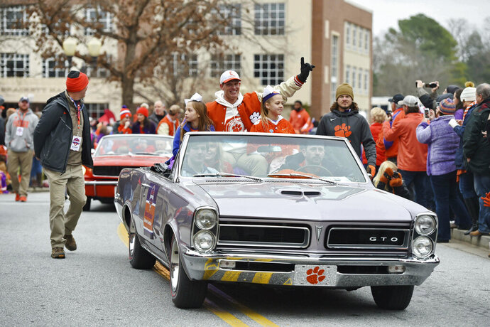 Defensive head coach Brent Venables, along with family members ride in the parade honoring Clemson Saturday, Jan. 12, 2019, in Clemson, S.C.,  The Tigers defeated Alabama 44-16 in the College Football Playoff championship game Monday Jan. 7. (AP Photo/Richard Shiro)