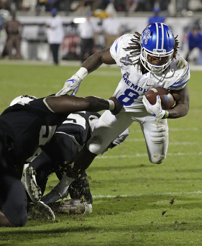 Memphis running back Darrell Henderson (8) struggles for yardage against the Central Florida defense during the second half of the American Athletic Conference championship NCAA college football game, Saturday, Dec. 1, 2018, in Orlando, Fla. (AP Photo/John Raoux)