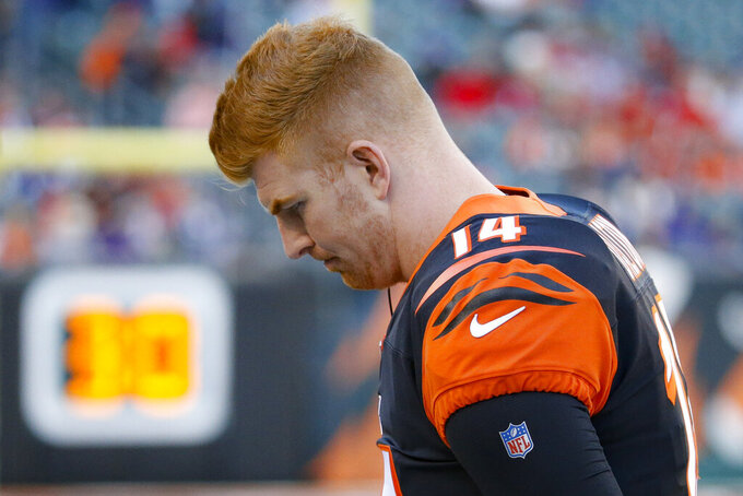 Cincinnati Bengals quarterback Andy Dalton works the sidelines during the second half of NFL football game against the Baltimore Ravens, Sunday, Nov. 10, 2019, in Cincinnati. (AP Photo/Frank Victores)