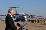 FILE - In this Dec. 12, 2017, file photo, Russian President Vladimir Putin addresses the troops at the Hemeimeem air base in Syria. In an interview on Russian state television, Putin, ahead of his June 16, 2021, meeting with President Joe Biden, issued a strong, new warning that the prospect of Ukraine joining NATO was unacceptable for Russia. (Mikhail Klimentyev/Pool Photo via AP, File)