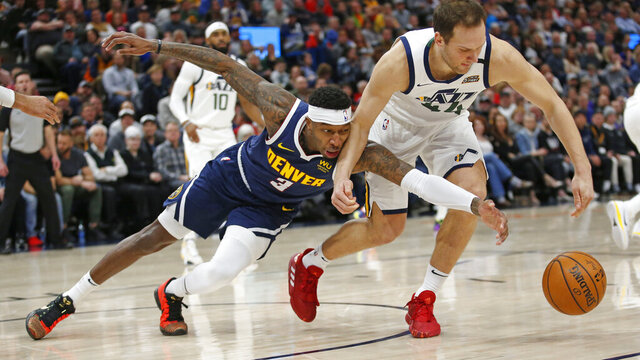 Denver Nuggets forward Torrey Craig (3) and Utah Jazz forward Bojan Bogdanovic (44) battle for a loose ball in the first half during an NBA basketball game Wednesday, Feb. 5, 2020, in Salt Lake City. (AP Photo/Rick Bowmer)