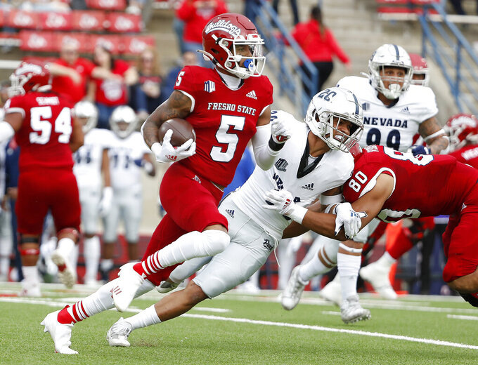 Fresno State wide receiver Jalen Cropper heads for a long gain against Nevada during the first half of an NCAA college football game in Fresno, Calif., Saturday, Oct. 23, 2021. (AP Photo/Gary Kazanjian)