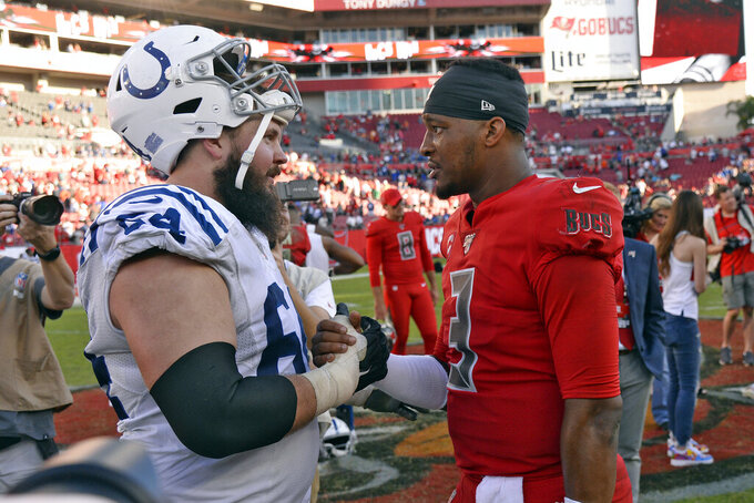 Tampa Bay Buccaneers quarterback Jameis Winston (3) talks to Indianapolis Colts offensive guard Mark Glowinski (64) after an NFL football game Sunday, Dec. 8, 2019, in Tampa, Fla. (AP Photo/Jason Behnken)