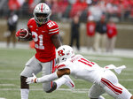 Ohio State receiver Parris Campbell, left, tries to escape the grasp of Rutgers defensive back Isaiah Wharton during the first half of an NCAA college football game Saturday, Sept. 8, 2018, in Columbus, Ohio. (AP Photo/Jay LaPrete)