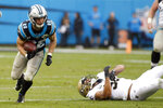 Carolina Panthers running back Christian McCaffrey (22) breaks a tackle by New Orleans Saints linebacker Craig Robertson (52) during the second half of an NFL football game in Charlotte, N.C., Sunday, Dec. 29, 2019. McCaffrey broke a record on the play to become the third player in NFL history to tally 1000 rushing and 1000 receiving yards in the same season. (AP Photo/Brian Blanco)