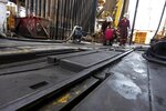 FILE - In this Sept. 18, 2010 file photo, roughnecks work on the drilling floor of Development Driller III, in the Gulf Of Mexico, off the coast of Louisiana. Attempts to curb the spread of COVID-19 have visited a kind of triple economic whammy on the state. As oil prices have plummeted, the industry laid off workers. Tourism has dried up, meaning more lost jobs. And one major tourist draw — cuisine built around fin fish, shrimp, oyster and crabs — is also suffering. (AP Photo/Gerald Herbert, File)