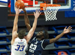 Utah State center Neemias Queta blocks a shot by Boise State forward Mladen Armus during the first half of an NCAA college basketball game, Wednesday, Feb. 17, 2021 at ExtraMile Arena in Boise, Idaho. (Darin Oswald/Idaho Statesman via AP)