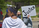 People gather at Roosevelt Park in Benton Harbor, Mich., Sunday, May 31, 2020, during a peaceful protest march held concerning police brutality and the death of black men including George Floyd who died after being restrained by Minneapolis police officers on May 25. (Don Campbell/The Herald-Palladium via AP)