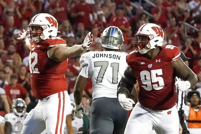 Wisconsin's Matt Henningsen (92) reacts after his sack during the first half of an NCAA college football game against Eastern Michigan Saturday, Sept. 11, 2021, in Madison, Wis. (AP Photo/Morry Gash)