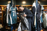 Philadelphia Eagles offensive guard Brandon Brooks cleans out his locker at the NFL football team's practice facility in Philadelphia, Monday, Jan. 6, 2020. The Eagles ended their season with a 17-9 loss to the Seattle Seahawks on Sunday. (AP Photo/Matt Rourke)