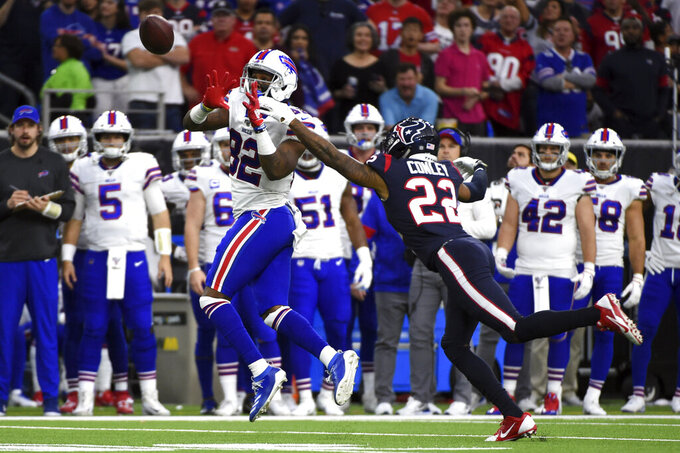 Buffalo Bills wide receiver Duke Williams (82) reaches to catch a pass as Houston Texans cornerback Gareon Conley (22) defends during the first half of an NFL wild-card playoff football game Saturday, Jan. 4, 2020, in Houston. (AP Photo/Eric Christian Smith)