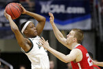 Michigan State's Cassius Winston, left, is defended by Bradley's Nate Kennell (25) during the first half of a first round men's college basketball game in the NCAA Tournament in Des Moines, Iowa, Thursday, March 21, 2019. (AP Photo/Nati Harnik)