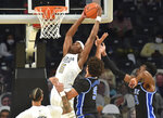 Georgia Tech forward Moses Wright (5) grabs a rebound during the first half of the team's NCAA college basketball game against Duke on Tuesday, March 2, 2021, in Atlanta. (Hyosub Shin/Atlanta Journal-Constitution via AP)