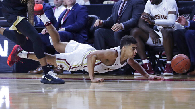 Boston College guard Derryck Thornton (11) dives for the ball against Wake Forest during the second half of an NCAA college basketball game in Boston, Wednesday, Nov. 6, 2019. Thornton scored 23 in Boston College's 77-70 win. (AP Photo/Charles Krupa)