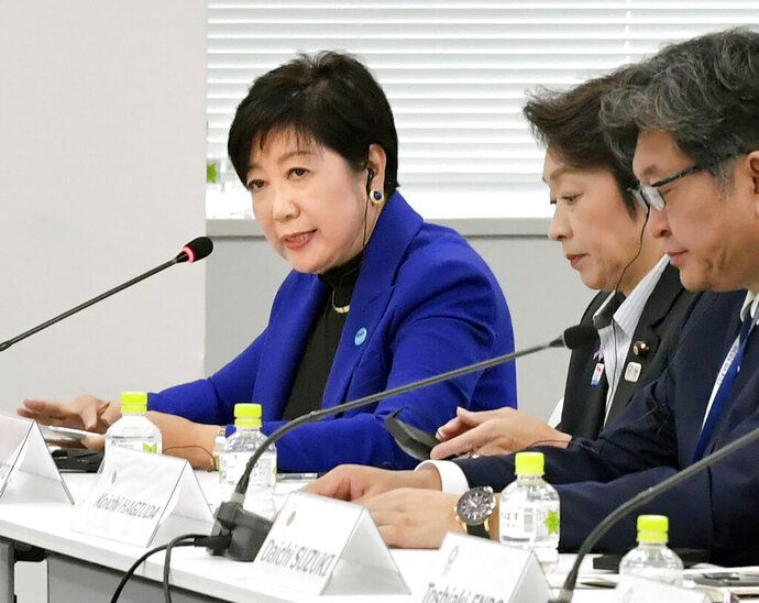 Tokyo Governor Yuriko Koike, left, speaks during a meeting with the International Olympic Committee officials in Tokyo Wednesday, Oct. 30, 2019.  Tokyo Governor Koike has told powerful IOC members she wants the Olympic marathon held in Tokyo and lashed out at what she called an