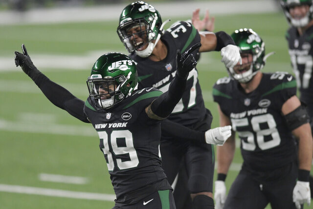 New York Jets' Bennett Jackson, left, celebrates a tackle during the first half of an NFL football game against the New England Patriots, Monday, Nov. 9, 2020, in East Rutherford, N.J. (AP Photo/Bill Kostroun)
