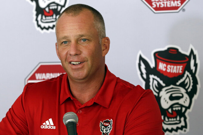 North Carolina State coach Dave Doeren responds to questions during the team's NCAA college football media day in Raleigh, N.C., Sunday, Aug. 11, 2019. (AP Photo/Gerry Broome)