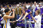 LSU guard Tremont Waters, left, celebrates the win against Auburn with the student section after an NCAA college basketball game, Saturday, Feb. 9, 2019, in Baton Rouge, La. LSU won 83-78. (AP Photo/Bill Feig)