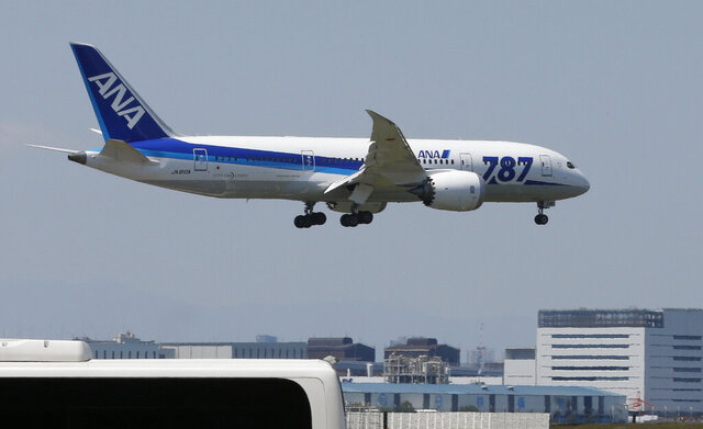 FILE - In this Sunday, April 28, 2013 file photo, a Boeing 787 plane of the All Nippon Airways, ANA, prepares to land after a test flight at Haneda Airport in Tokyo. Japanese carrier ANA is ordering 20 Boeing 787 Dreamliner jets, bringing its fleet of the planes to 103 by 2025. (AP Photo/Shizuo Kambayashi, File)