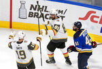 St. Louis Blues' Robert Bortuzzo (41) looks on as Vegas Golden Knights' Reilly Smith (19) and teammate Alex Tuch (89) celebrate a goal during the second period of an NHL hockey playoff game Thursday, Aug. 6, 2020, in Edmonton, Alberta. (Jason Franson/Canadian Press via AP)