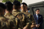Italian Prime Minister Giuseppe Conte, right, addresses Italian soldiers as he visits an Italian field hospital set up at the Lebanese University in the Hadath district of Beirut, Lebanon, Tuesday, Sept. 8, 2020. Conte said Tuesday his country will support Lebanon's economic and social growth, expressing hopes that a new government is formed quickly — one that would start the reconstruction process in the wake of last month's Beirut explosion and implement badly needed reforms. (AP Photo/Hassan Ammar)