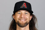 FILE - This is a 2020 photo photo showing Mike Leake of the Arizona Diamondbacks baseball team. Diamondbacks right-hander Mike Leake has opted out of the 2020 season due to concerns about the coronavirus. Diamondbacks general manager Mike Hazen did not elaborate on Leake's decision during a Zoom call, but the pitcher's agent issued a statement saying he made a personal decision not to play during the pandemic.  (AP Photo/Darron Cummings, File)