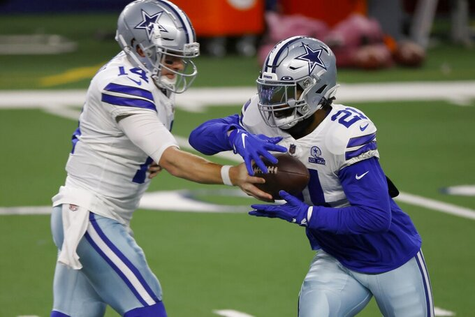 Dallas Cowboys' Andy Dalton hands the ball off to Ezekiel Elliott (21) during warmups before an NFL football game against the Arizona Cardinals in Arlington, Texas, Monday, Oct. 19, 2020. (AP Photo/Ron Jenkins)