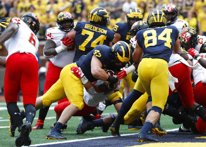 Michigan fullback Ben Mason (42) scores on a one-yard touchdown run against Maryland in the first half of an NCAA football game in Ann Arbor, Mich., Saturday, Oct. 6, 2018. (AP Photo/Paul Sancya)