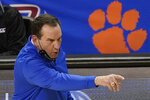 Duke head coach Mike Krzyzewski directs his team during the second half of an NCAA college basketball game against Boston College in the first round of the Atlantic Coast Conference tournament in Greensboro, N.C., Tuesday, March 9, 2021. (AP Photo/Gerry Broome)