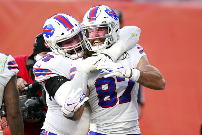 Buffalo Bills wide receiver Jake Kumerow, right, celebrates with teammate center Jon Feliciano after scoring a touchdown during the first half of an NFL football game against the Denver Broncos, Saturday, Dec. 19, 2020, in Denver. (AP Photo/David Zalubowski)