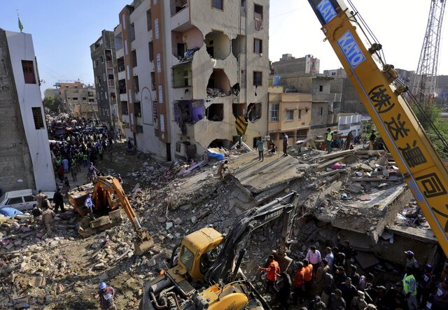 Pakistan troops, rescue workers and volunteers look for survivors amid the rubble of a collapsed building in Karachi, Pakistan, Thursday, Sept. 10, 2020. The multi-story residential building collapsed in a neighborhood of Karachi, killing and injuring some people, local media reported. (AP Photo/Fareed Khan)