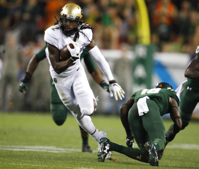 Colorado wide receiver Laviska Shenault Jr., left, runs for a gain after pulling in a pass in front of Colorado State defensive back Braylin Scott in the first half of an NCAA college football game Friday, Aug. 31, 2018, in Denver. (AP Photo/David Zalubowski)