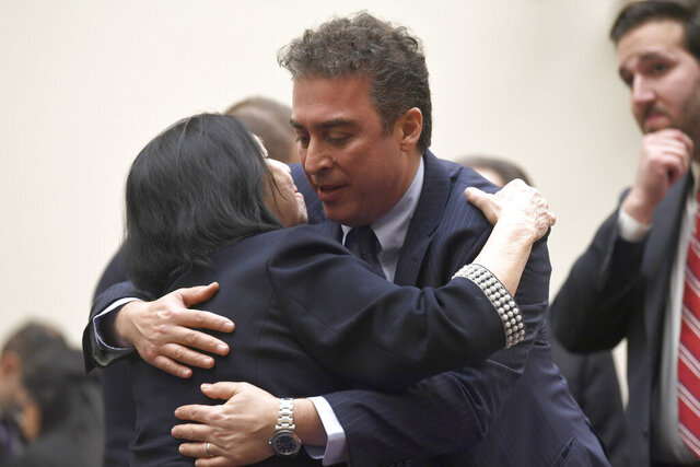FILE - In this March 7, 2019, file photo, Christine Levinson, wife of Robert Levinson, a former FBI agent who vanished in Iran in 2007, left, gets a hug from Babak Namazi, right, the son of Baquer Namazi who has been held in Iran, following their testimony before a House Foreign Affairs Subcommittee on Capitol Hill in Washington. The killing of a top Iranian general has ratcheted up the anxiety of families of Americans held in Iran.  (AP Photo/Susan Walsh, File)