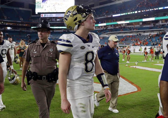 Pittsburgh quarterback Kenny Pickett (8) walks off the field after an NCAA college football game against Miami, Saturday, Nov. 24, 2018, in Miami Gardens, Fla. Miami won 24-3. (AP Photo/Lynne Sladky)