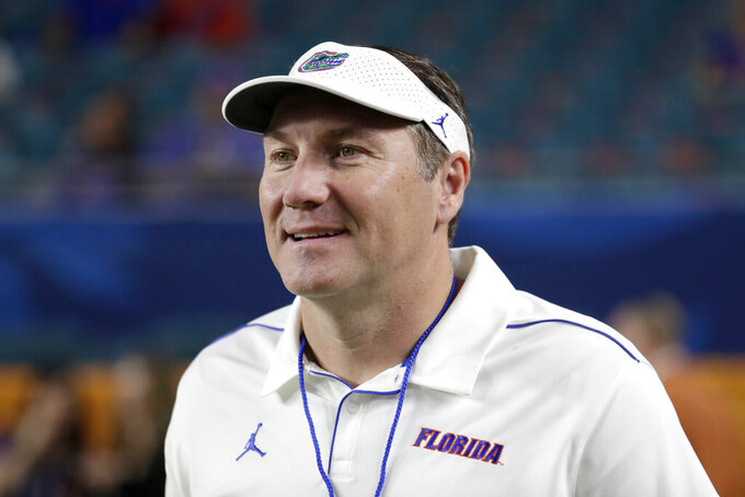 FILE - Florida head coach Dan Mullen walks on the field before the Orange Bowl NCAA college football game against Virginia in Miami Gardens, Fla., in this Monday, Dec. 30, 2019, file photo.  Florida football coach Dan Mullen received a three-year contract extension worth an additional $1.5 million annually following a disappointing season that closed with a three-game losing streak and included several public relations missteps and NCAA sanctions. The Gators released Mullen's contract Tuesday, June 1, 2021, in response to a public records request. (AP Photo/Lynne Sladky, File)