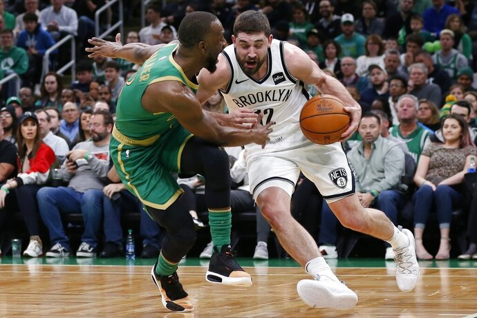 Boston Celtics' Kemba Walker (8) defends against Brooklyn Nets' Joe Harris (12) during the first half of an NBA basketball game in Boston, Wednesday, Nov. 27, 2019. (AP Photo/Michael Dwyer)