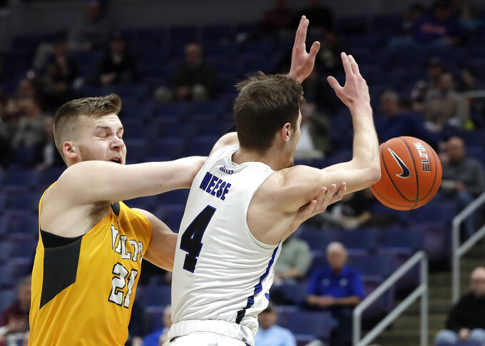 Valparaiso's Derrik Smits (21) and Indiana State's Cooper Neese (4) collide while reaching for the ball during the first half of an NCAA college basketball game in the first round of the Missouri Valley Conference men's tournament Thursday, March 7, 2019, in St. Louis. (AP Photo/Jeff Roberson)