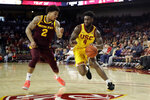 Southern California guard Daniel Utomi (4) dribbles next to Arizona State guard Rob Edwards (2) during the first half of an NCAA college basketball game Saturday, Feb. 29, 2020, in Los Angeles. (AP Photo/Marcio Jose Sanchez)