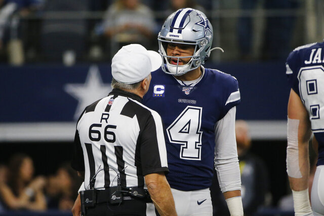 Dallas Cowboys quarterback Dak Prescott (4) talks with referee Walt Anderson (66) in the first quarter of an NFL football game against the Los Angeles Rams in Arlington, Texas, Sunday, Dec. 15, 2019. (AP Photo/Michael Ainsworth)