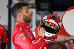 Bubba Wallace removes his helmet in his garage after a NASCAR Daytona 500 auto race practice session at Daytona International Speedway, Wednesday, Feb. 10, 2021, in Daytona Beach, Fla. Wallace turned the fastest time for the practice session. (AP Photo/John Raoux)