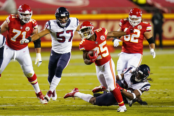 Kansas City Chiefs running back Clyde Edwards-Helaire (25) carries the ball against the Houston Texans in the first half of an NFL football game Thursday, Sept. 10, 2020, in Kansas City, Mo. (AP Photo/Jeff Roberson)