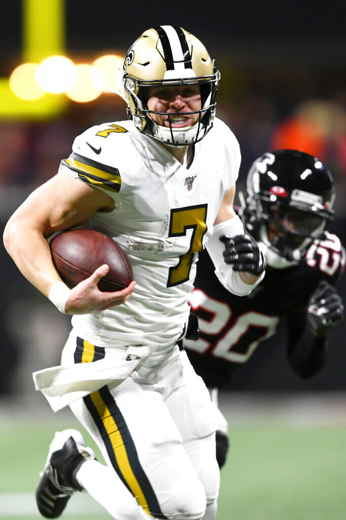 New Orleans Saints quarterback Taysom Hill (7) runs for a touchdown against the Atlanta Falcons during the first half of an NFL football game, Thursday, Nov. 28, 2019, in Atlanta. (AP Photo/John Amis)