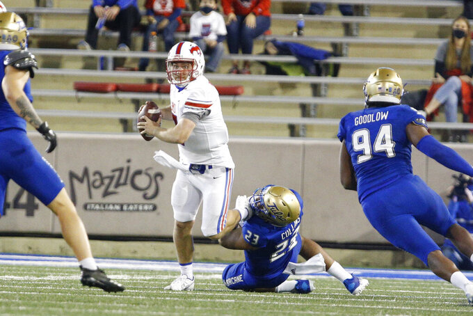 Tulsa linebacker Zaven Collins (23) sacks SMU quarterback Shane Buechele (7) during the first half of an NCAA college football game in Tulsa, Okla., Saturday, Nov. 14, 2020. (AP Photo/Joey Johnson)
