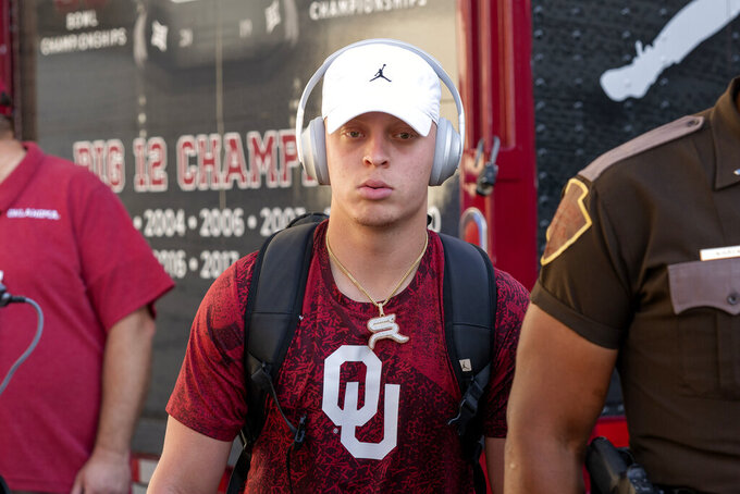Oklahoma quarterback Spencer Rattler walks from the bus into the Cotton Bowl stadium before an NCAA college football game against Texas, Saturday, Oct. 9, 2021, in Dallas. (AP Photo/Jeffrey McWhorter)