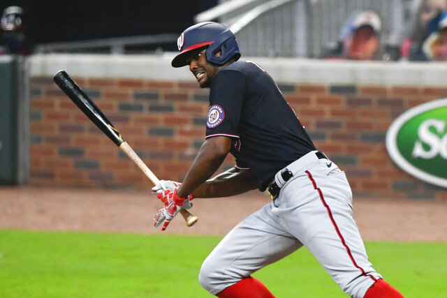 Washington Nationals' Michael Taylor connects for a two-run ground ball double to left field during the third inning of the second baseball game of a doubleheader against the Atlanta Braves, Friday, Sept. 4, 2020, in Atlanta. (AP Photo/John Amis)