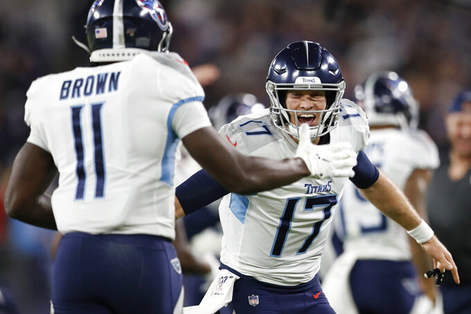 Tennessee Titans quarterback Ryan Tannehill (17) celebrates a touchdown against the Baltimore Ravens during the second half an NFL divisional playoff football game, Saturday, Jan. 11, 2020, in Baltimore. (AP Photo/Julio Cortez)