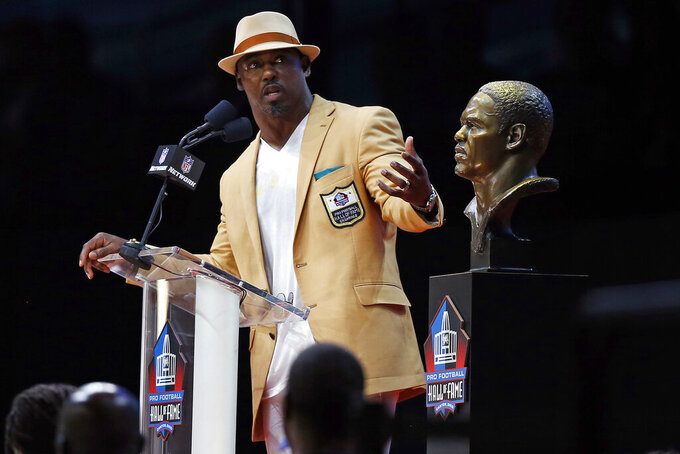 FILE - In this Aug. 4, 2018, file photo, former NFL safety Brian Dawkins delivers his induction speech at the Pro Football Hall of Fame in Canton, Ohio. Dawkins was the heart and soul on defense during the team's impressive run of success in the 2000s.(AP Photo/Ron Schwane, File)