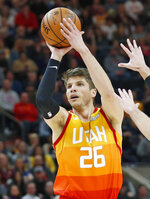 FILE - In this Jan. 14, 2019, file photo, Utah Jazz guard Kyle Korver (26) looks to shoot against the Detroit Pistons during the second half of an NBA basketball game, in Salt Lake City. A person with knowledge of the decision says the Memphis Grizzlies have traded veteran point guard Mike Conley, who has played the most games in franchise history, to the Utah Jazz. The person says the Grizzlies swapped Conley for Jae Crowder, Kyle Korver and Grayson Allen. The person spoke to The Associated Press Wednesday, June 19, 2019, on condition of anonymity because neither Memphis nor Utah has announced the trade (AP Photo/Rick Bowmer, File)