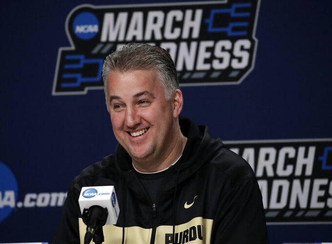 Purdue's head coach Matt Painter smiles during a news conference at the NCAA men's college basketball tournament, Friday, March 22, 2019, in Hartford, Conn. Purdue will play Villanova on Saturday. (AP Photo/Elise Amendola)