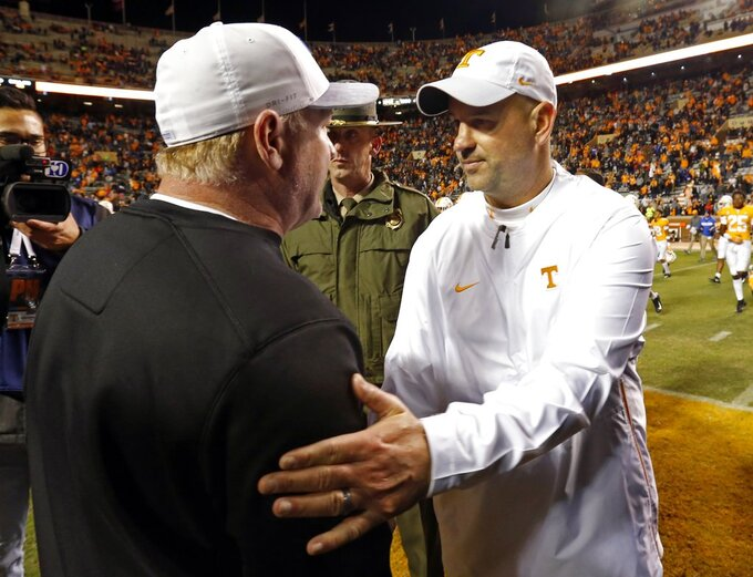 Tennessee head coach Jeremy Pruitt, right, meets with Kentucky head coach Mark Stoops after an NCAA college football game Saturday, Nov. 10, 2018, in Knoxville, Tenn. Tennessee won 24-7. (AP Photo/Wade Payne)